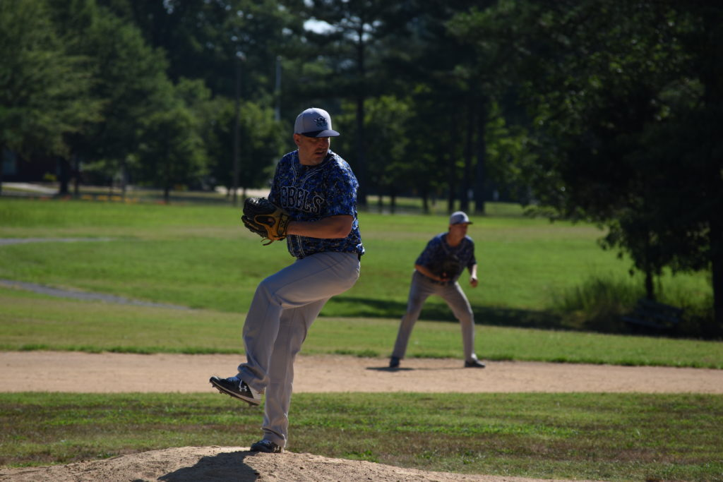 Joey Sogluizzo pitching for the Rebels